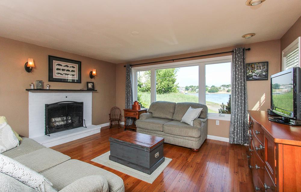 Living room with fireplace and hardwood floors 18 Hobart Avenue Beverly Massachusetts