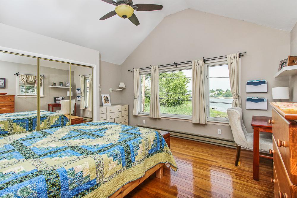 Main bedroom hardwood floors ceiling fan and picture window 18 Hobart Avenue Beverly Massachusetts