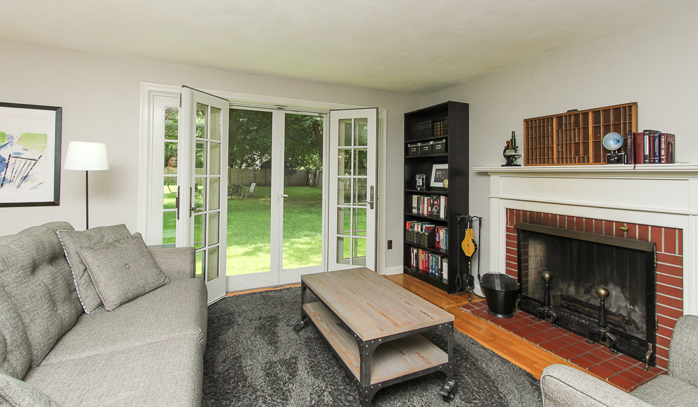 Fireplace and French doors in the living room 43 Homestead Circle Hamilton MA