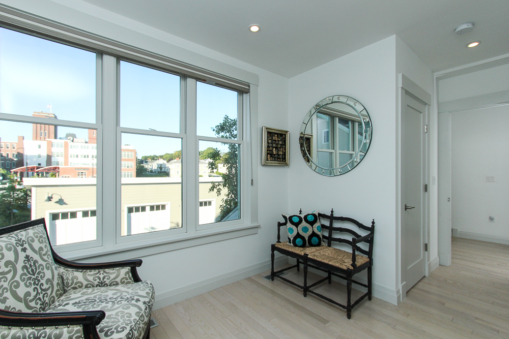 First floor bedroom with seating in front of the window 266 Merrimac Street Newburyport Massachusetts - Unit D