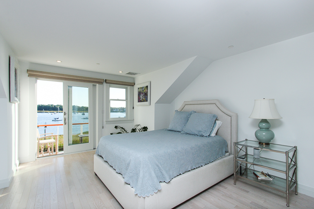 Main bedroom and glass sliding doors to the deck 266 Merrimac Street Newburyport Massachusetts - Unit D
