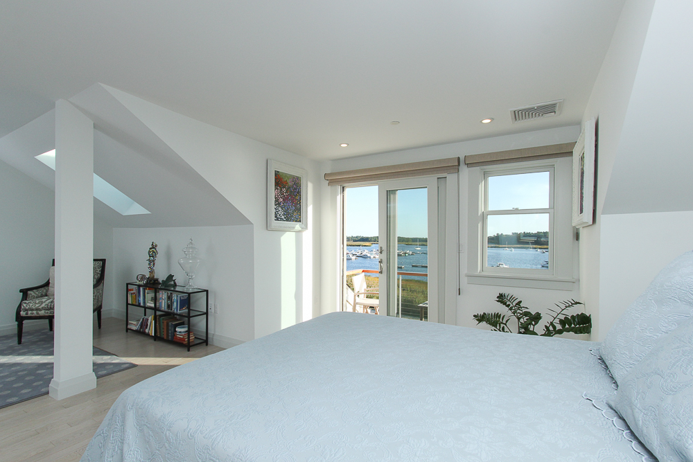 Main bedroom with seating area and skylight 266 Merrimac Street Newburyport Massachusetts - Unit D