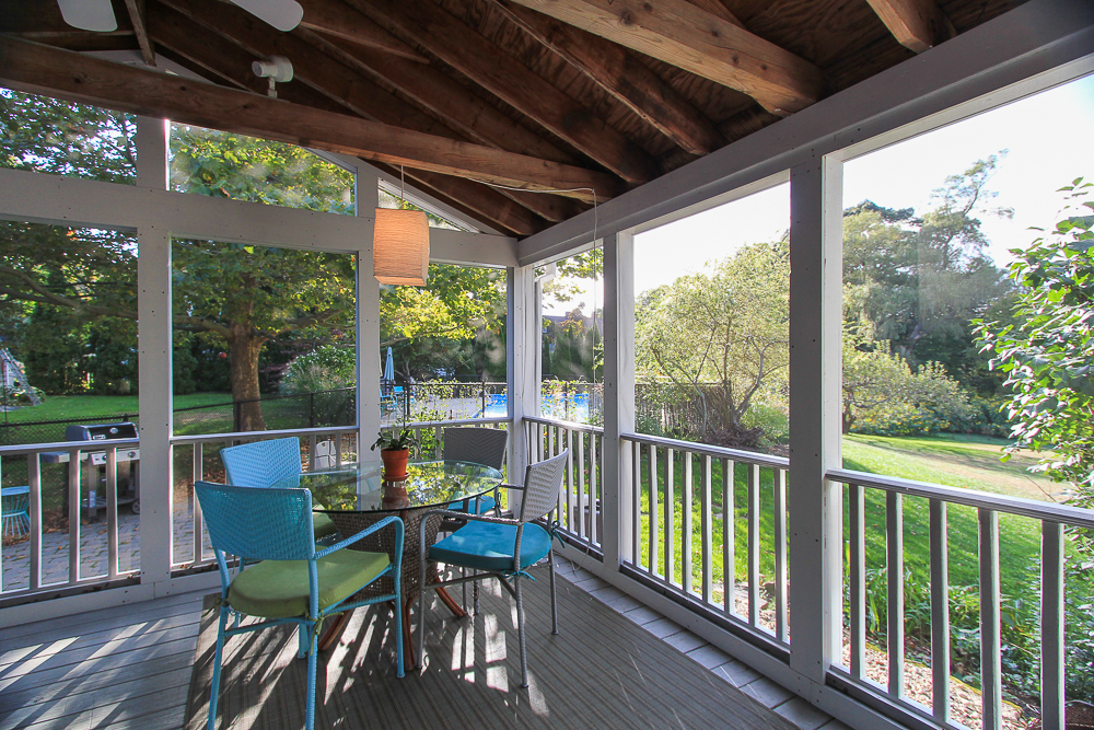 Screened porch with pool in the background 72 Hamilton Avenue Hamilton, MA