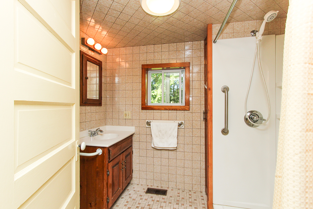 First floor bathroom with tiled walls and walk-in shower 115 South Main Street Topsfield Massachusetts