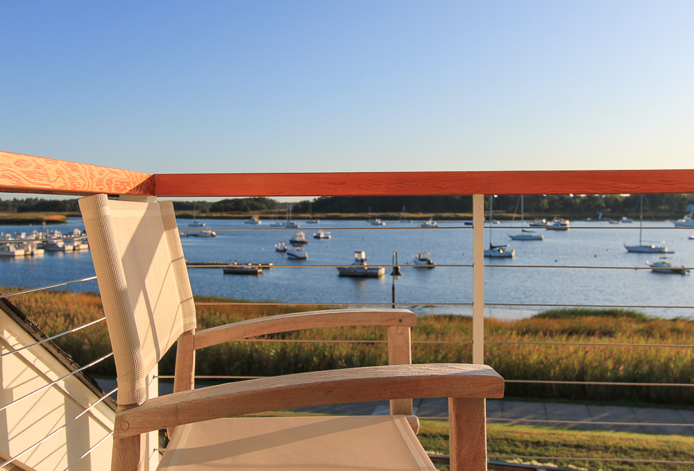 Chair on the Main bedroom deck with the Merrimac River beyond 266 Merrimac Street Newburyport Massachusetts - Unit D
