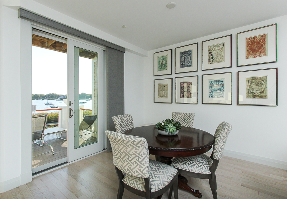 Dining room with sliding glass doors to the deck 266 Merrimac Street Newburyport Massachusetts - Unit D