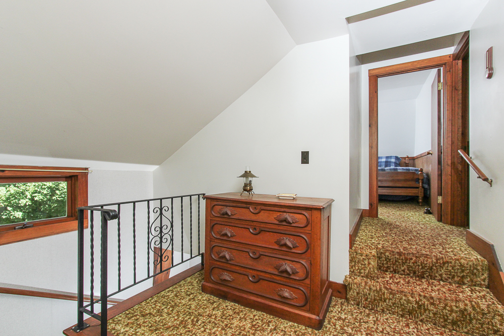 Second floor hallway with carpet and wrought iron rail 115 South Main Street Topsfield Massachusetts