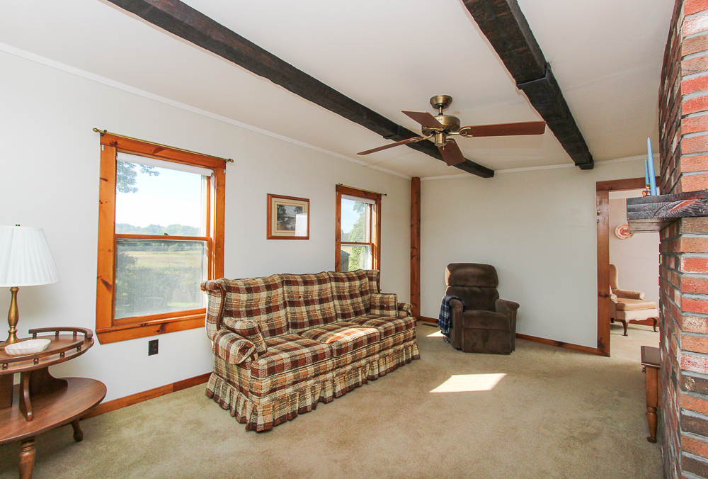 Living room with carpet and ceiling fan 115 South Main Street Topsfield Massachusetts