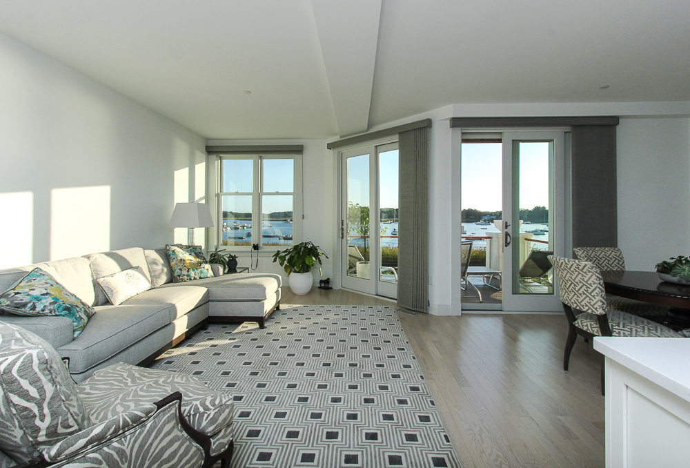 Living room with glass doors to deck from living and dining rooms 266 Merrimac Street Newburyport Massachusetts - Unit D