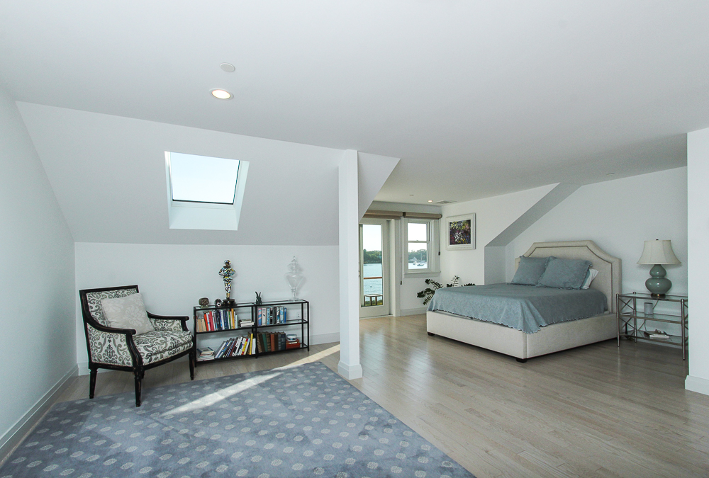 Main bedroom with door to a deck 266 Merrimac Street Newburyport Massachusetts - Unit D
