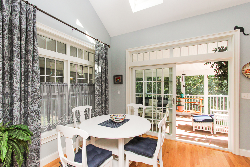 Kitchen dining area looking out to screened porch 1B Plover Street Gloucester, MA