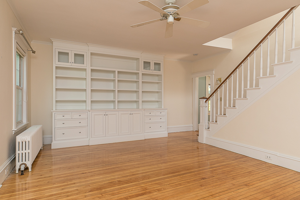Living room with built-ins and stairway to the second floor at 38 Arbor Street Hamilton Massachusetts