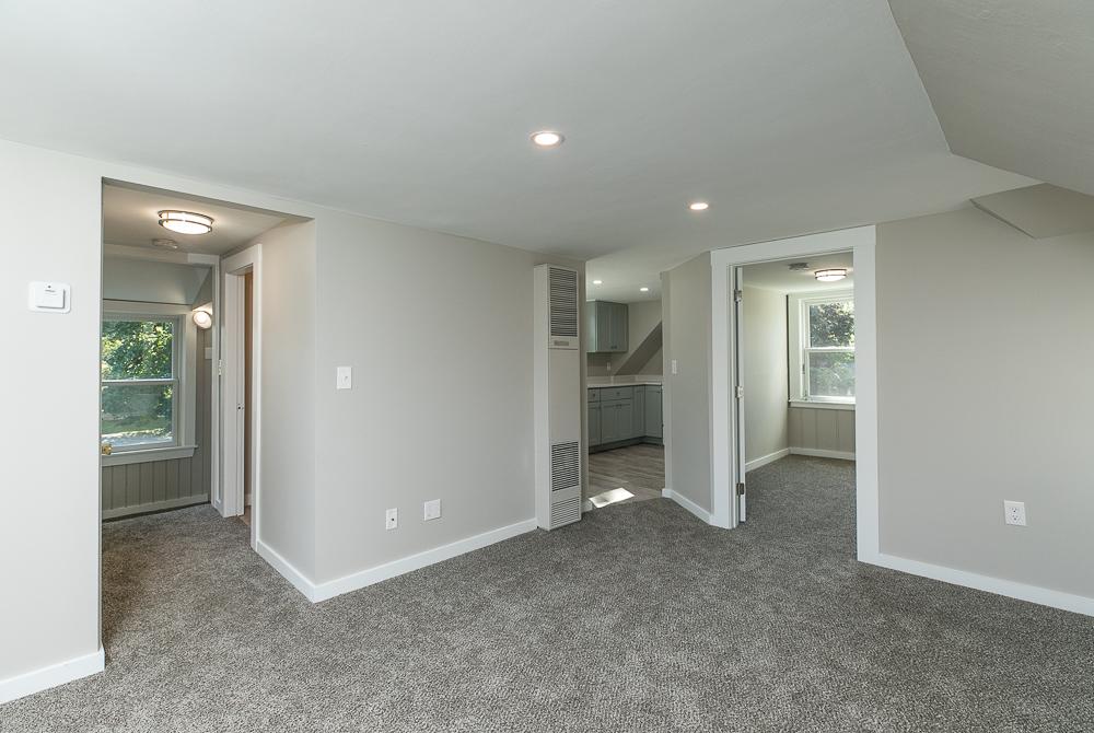Living room with hallway, kitchen and bedroom beyond 38-C Arbor Street Wenham Massachusetts