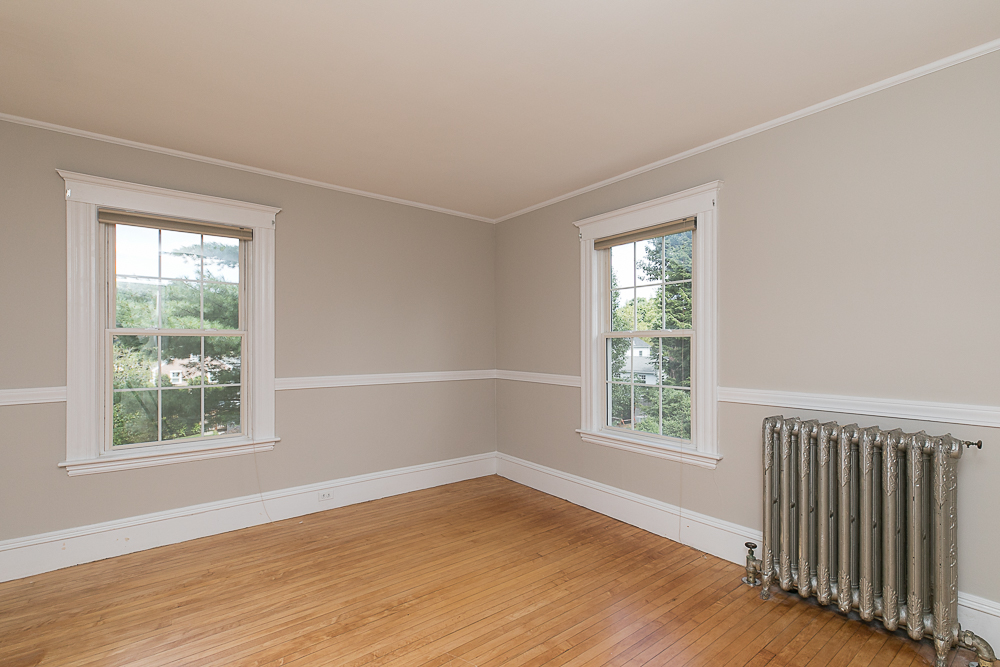 Bedroom with hardwood floors at 38 Arbor Street Hamilton Massachusetts