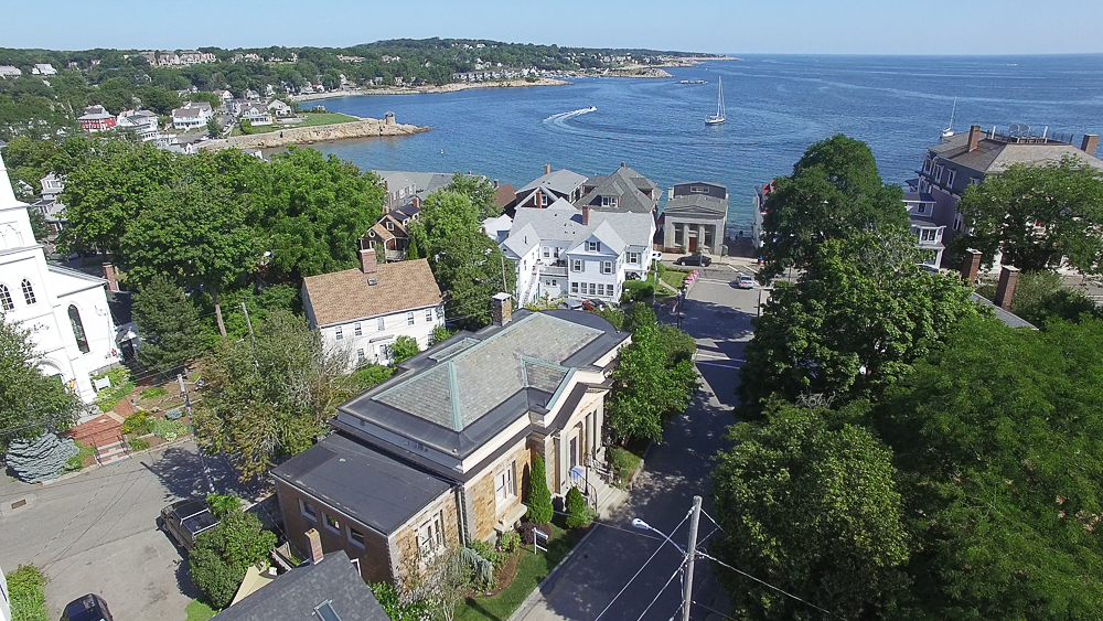 Aerial of the house and water beyond 18 Jewett Street Rockport Massachusetts