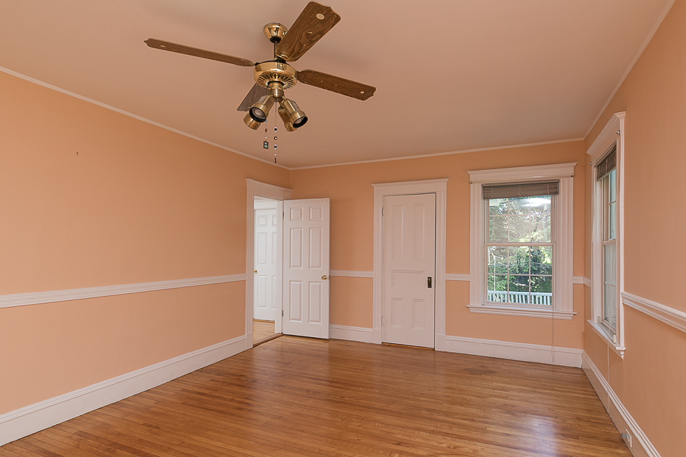 Bedroom with hardwood floors and ceiling fan at 38 Arbor Street Hamilton Massachusetts