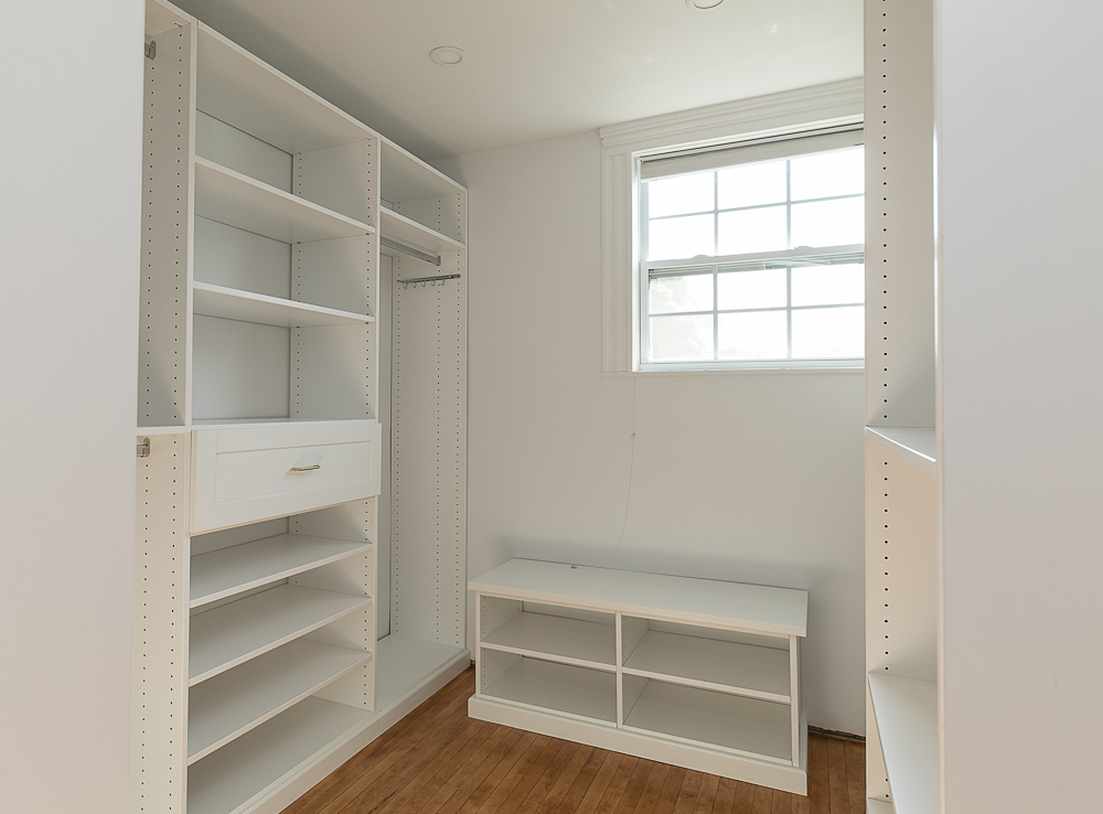 Walk-in closet with shelves at 38 Arbor Street Hamilton Massachusetts