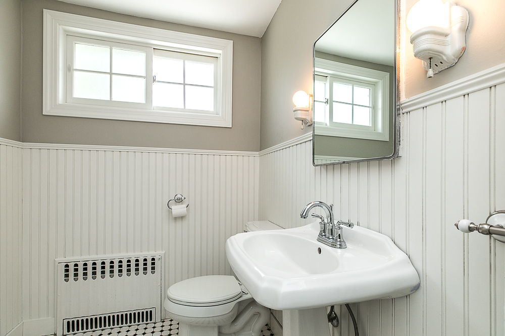 Hald bath with tile floor and wainscotting at 38 Arbor Street Hamilton Massachusetts