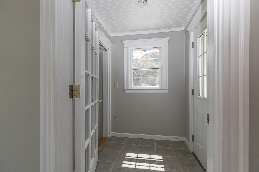 Mudroom with tile floor at 38 Arbor Street Hamilton Massachusetts