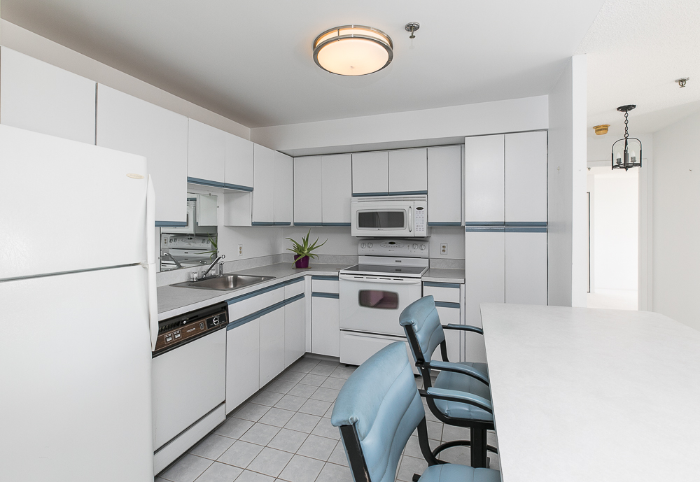 Kitchen with chairs at the counter 510-1002 Revere Beach BLVD Revere Massachusetts