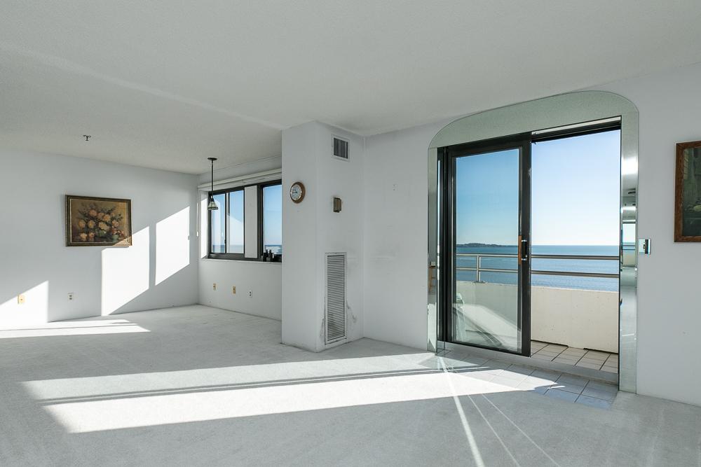 Living room with sliders and window 510-1002 Revere Beach BLVD Revere Massachusetts
