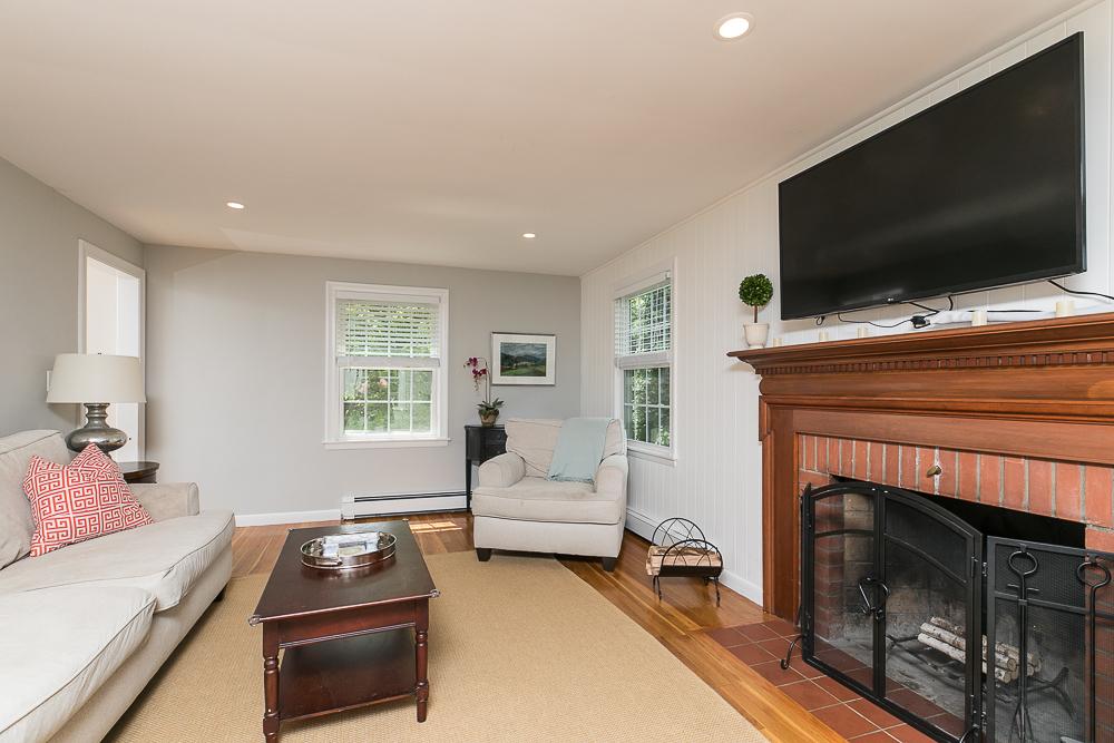 Living Room with fireplace 300 Essex Street Hamilton Massachusetts