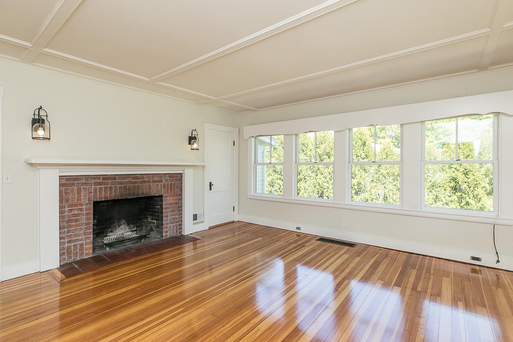Living room with hardwood floors and fireplace 40 Atlantic Avenue Rockport Massachusetts