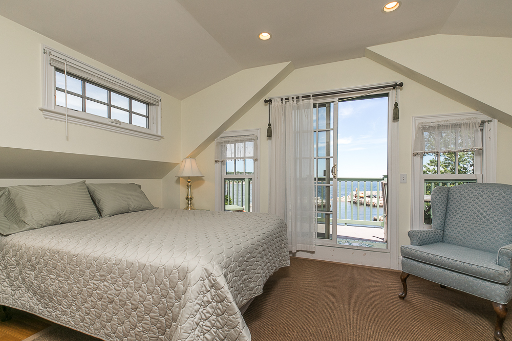 Bedroom with sliders to the deck 1 Main Street Rockport Massachusetts