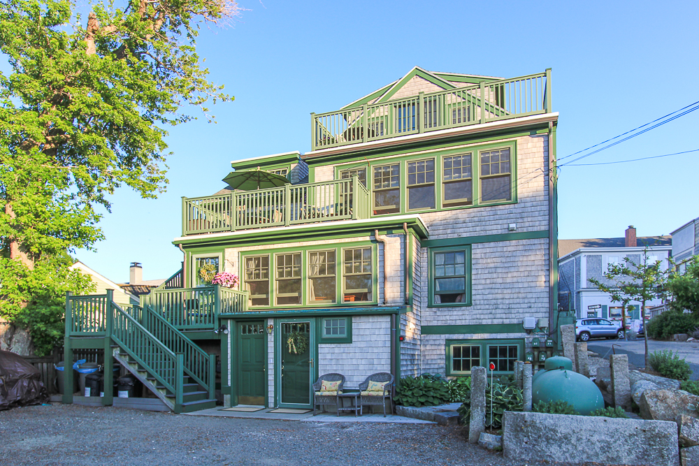 Rear view of the property in the evening 1 Main Street Rockport Massachusetts